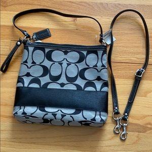A Coach purse or small tote bag or messenger bag
